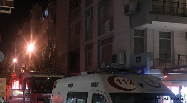 İzmir'de pencereden sarkarak polise direnen cezaevi firarisi ikna edilerek teslim oldu
