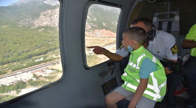 Kalbinde kitle olan 8 yaşındaki Ali'nin helikopterle uçma hayali gerçekleştirildi