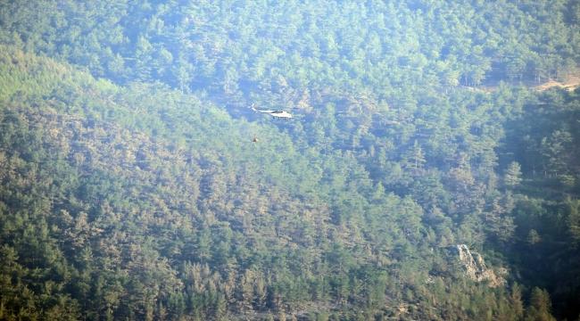 Mersin'de kontrol altına alınan orman yangını bölgesinde soğutma çalışmaları sürüyor